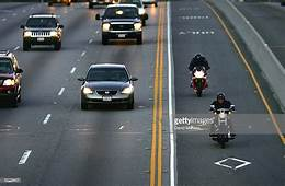 Two Motorcyclists Drive In The High Occupancy Vehicle Lane