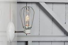 industrial wall l wire cage wall sconce light