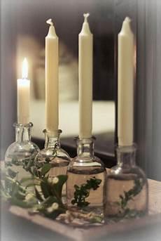 Kerzenständer Weihnachtlich Dekorieren - kerzenhalter aus kleinen glasflaschen voll wasser