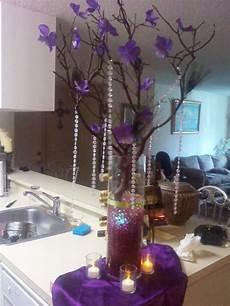diy centerpiece manzanita purple hydrangea and peacock