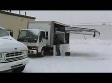 Mobile Garage mobile garage systems paints a car in blizzard using a