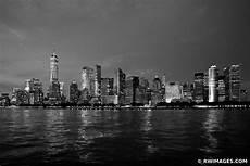 framed photo print of manhattan skyline city lights