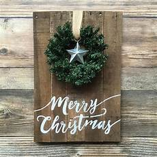 rustic painted merry christmas sign with wreath and tin star the good co