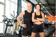 fitness male and female fit couple at the gym looking very attractive stock image