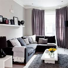 black and purple living room grey traditional living room with purple soft furnishings