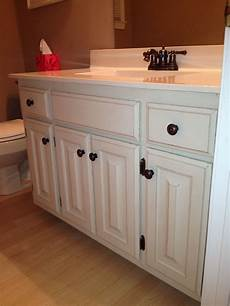 our bathroom after painting 80s honey oak cabinets with sloan chalk paint 2 coats old