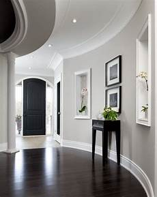 light gray walls white trim dark floors in this stunning
