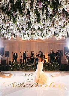 these insane floral designs are the definition of flower power ballroom wedding reception