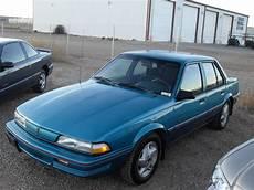 1992 pontiac sunbird 4 door the wife s aqua blurr lol it was a good car trucks and