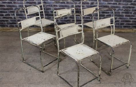 vintage industrial chairs white metal stacking