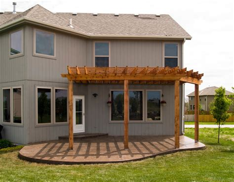 house cedar pergola with sted concrete patio