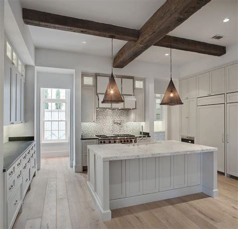 white mosaic tile backsplash black and white mosaic cooktop backsplash with white kitchen hood transitional kitchen
