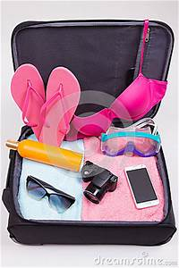 Vacation Concept - Open Suitcase Full Of Travel Items ...