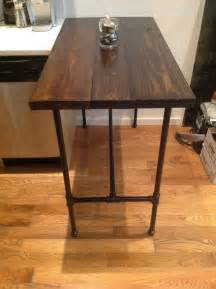 kitchen island with wine rack made reclaimed wood and black iron pipe table by
