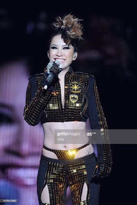 Chinese singer CoCo Lee performs during the EAST 2 WEST