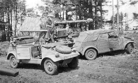 A Ferdinand Tank Destroyer With Two Vw Type 82 Kubelwagens