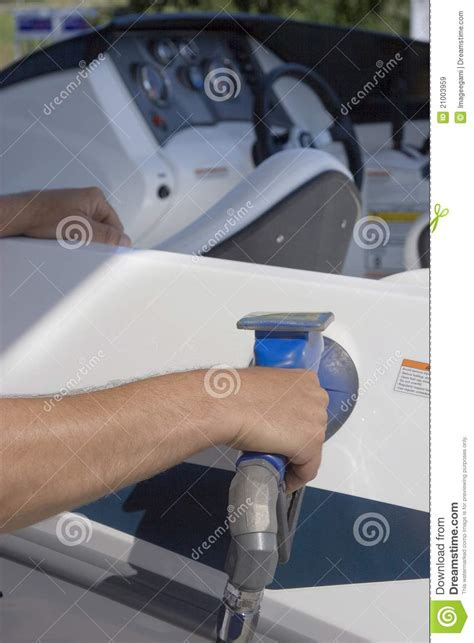 Man Filling His Boat With Fuel At A Gas Station Royalty