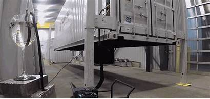 Shipping Lift Legs Containers Onto Pop Trucks