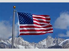 American flag and snow on Sierra Nevada Mountain Range