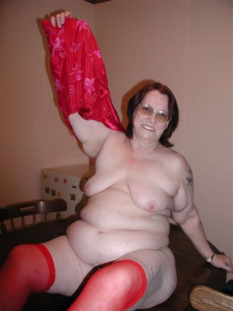 Big Ass Granny In Red Stockings Fucks Her Hairy Pussy With