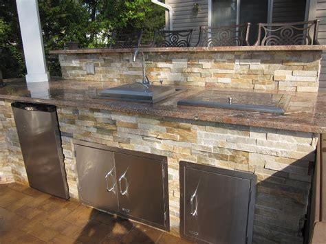 outdoor kitchen island with sink outdoor kitchen with dual bar top featuring outdoor fridge