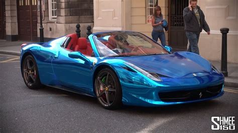chrome blue ferrari  spider supercar  saudi