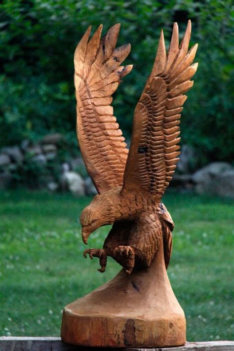 chainsaw carve  eagle part  youtube