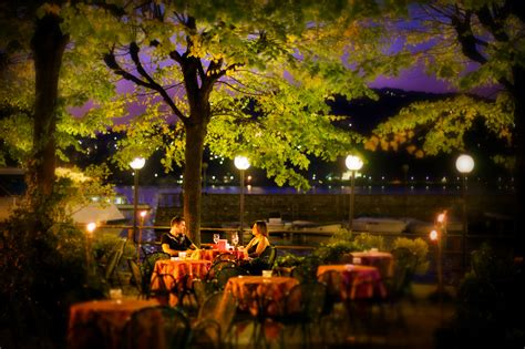lake como cafe  night italy photo  daniel peckham