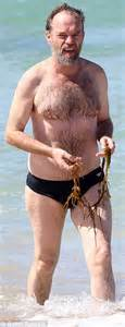 hugo weaving swimsuit hugo weaving in a pair of speedos while clutching a bunch