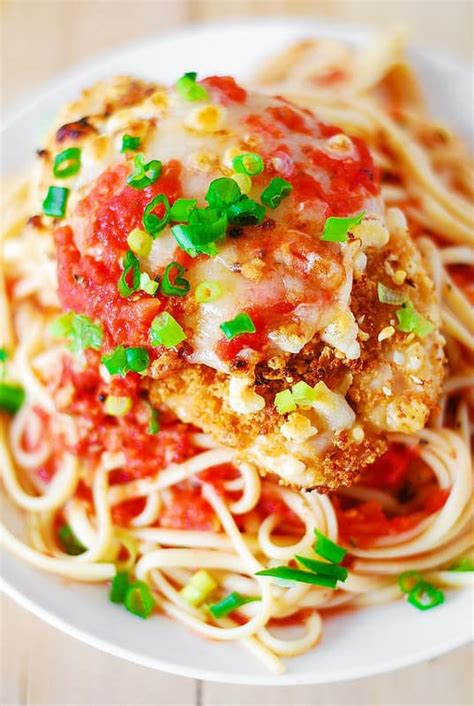 Pasta now plays a supporting role in this dish, and by bypassing the deep fryer and minimizing the oil in the pan, crispy chicken cutlets can still be delivered with a lot less fuss. Chicken parmesan pasta in a garlic tomato sauce