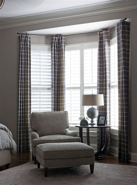 how to drape a bay window ideas for treating a bay window let s decorate bay