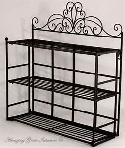 Wall shelves metal bathroom wall shelves black metal for Metal bathroom shelving unit