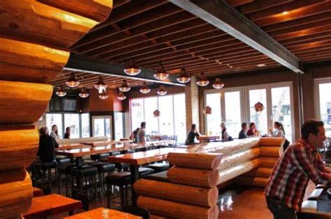 log cabin restaurant homeslice pizza brings log cabin to lincoln park