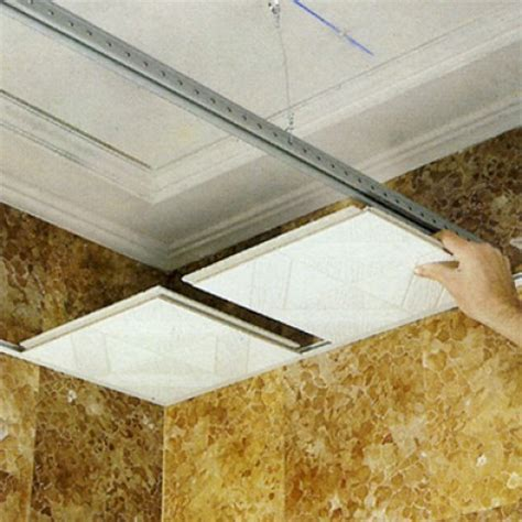 pose faux plafond suspendu dalle  maison travaux
