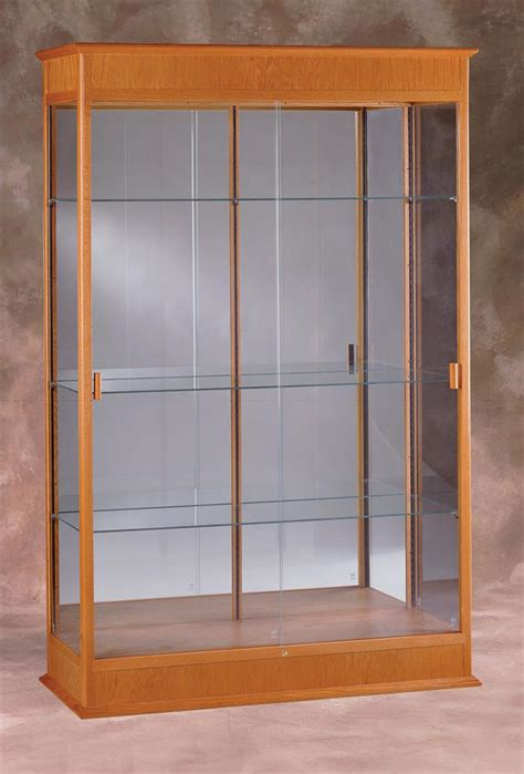 glass cabinet with lights this display cabinet mirrors awards and trophies in