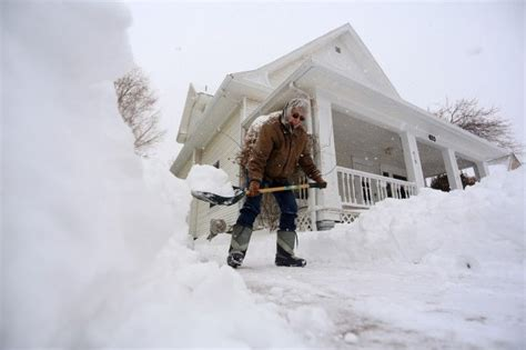 Kansas City MO Major Snowstorm Blankets Midwest Heads