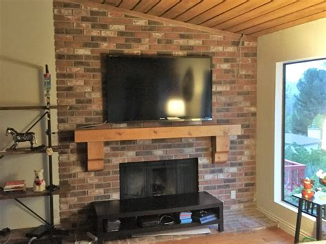 rustic fireplace mantle  flat screen tv installation