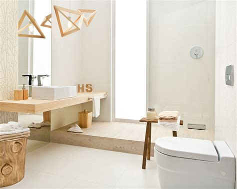 White bathroom in a hygge style with floral motif and natural wood Ceramika Paradyz