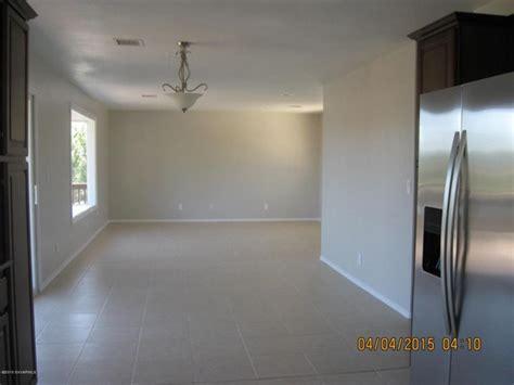 Can I DIY install laminate flooring over ceramic tile