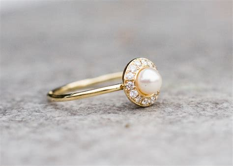 white pearl wedding ring with diamonds in 14k gold pearl