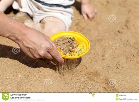 sifting sand  sandbox royalty  stock  image