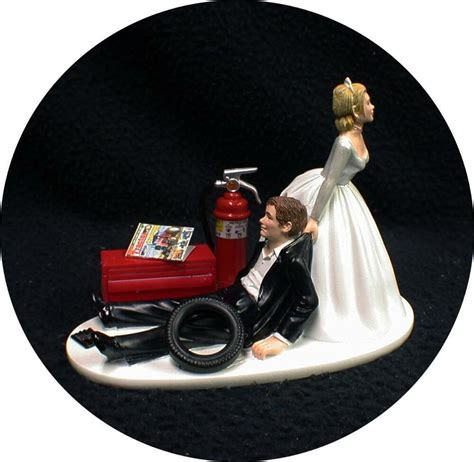 car auto mechanic wedding cake topper bride dragging groom