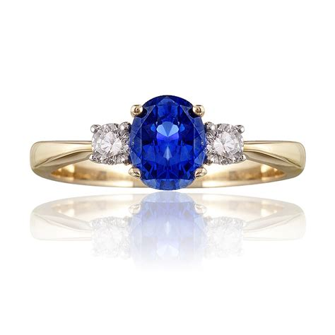 classic blue sapphire and trilogy ring woolfe jewellery