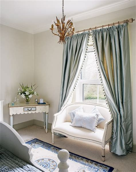 neutral bedroom  blue silk accents  gold pendant