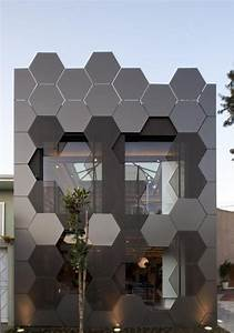 The honeycomb pattern exterior facade on this building is ...