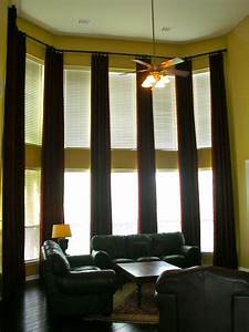 Curtains for tall windows installed by Decorating on a