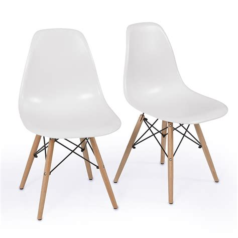 2 white armless plastic molded side dining chairs modern
