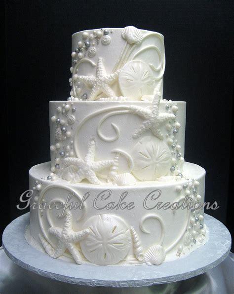 elegant beach themed white butter cream wedding cake