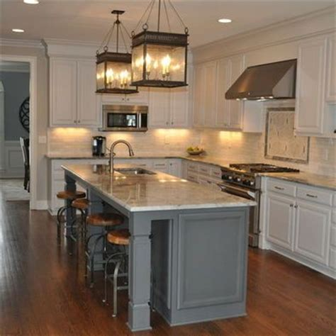 kitchen island with cupboards white cabinets grey island lanterns above island 5208