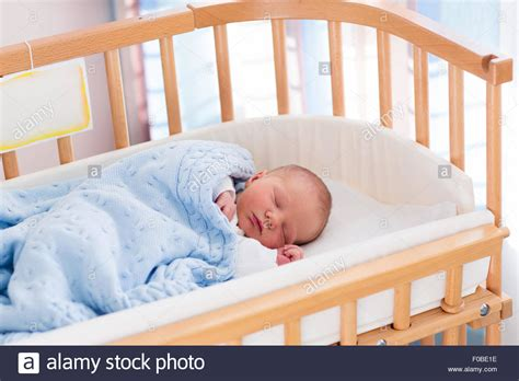 Newborn Baby Boy In Bed. New Born Child Sleeping Under A